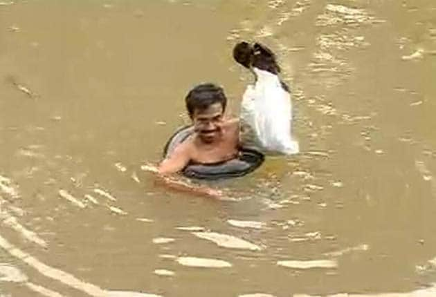 A teacher who swims through a river everyday to get to his students