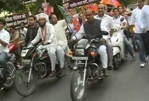 Delhi BJP protests fuel price hike by holding a 100-bike rally