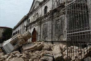Philippines earthquake: Search on for survivors as death toll hits 107
