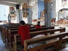 Toppled Philippine church cross overlooks typhoon's destruction