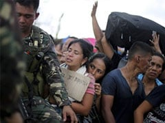UN says Philippine typhoon death toll 4,460, government disputes figure
