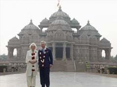 Britain's Prince Charles, wife visit slum school, Akshardham temple in Delhi