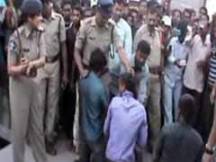 Action against Andhra Pradesh cops who thrashed murder suspects in public