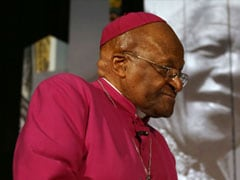 Desmond Tutu reverses course, says will attend Nelson Mandela's burial