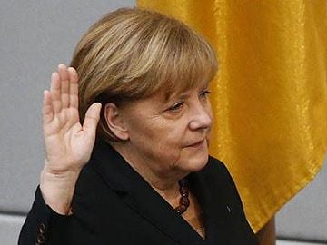 Germany's Angela Merkel begins third term with focus on Europe
