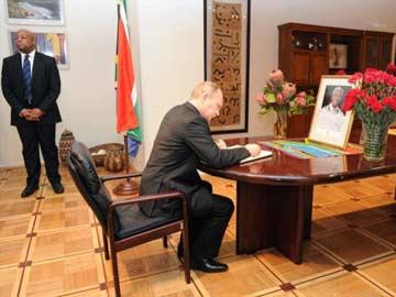 Putin compares Nelson Mandela to Gandhi, Solzhenitsyn