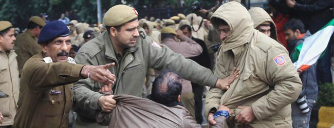 Protesters from Arvind Kejriwal's AAP break barricades, throw stones at cops
