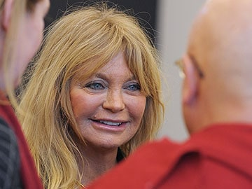 US actress Goldie Hawn gets Davos meditating