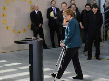 Angela Merkel makes first appearance on crutches after ski fall