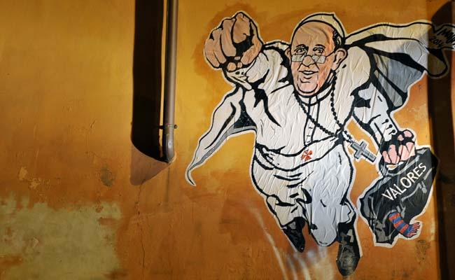 Pope as superman: Vatican tweets graffiti of hero pontiff