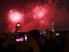 Revelers usher in 2014 with fireworks, festivities