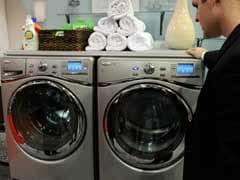 Nude washing machine Aussie says oil rescue like a 'birth'