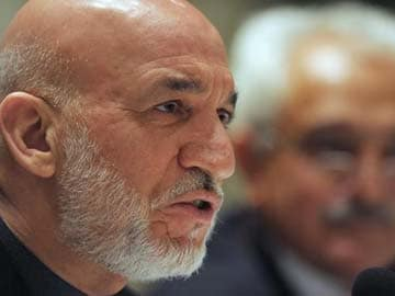 US intelligence director does not believe Hamid Karzai will sign security pact