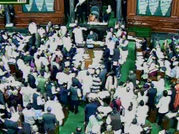 Telangana Bill passed in Lok Sabha: row over blackout; Kiran Kumar Reddy to resign, float new party