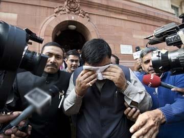MPs shame India, vandalise Parliament over Telangana