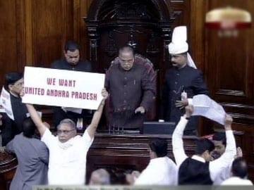 MPs turn vandals in Rajya Sabha. Papers torn, chairman's mic broken