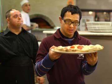Rome restaurant serves up new attitude toward Down syndrome