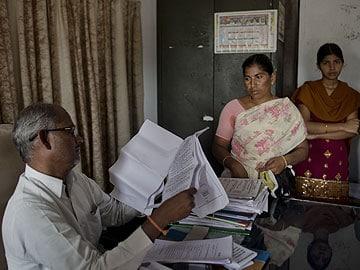 After India farm suicides, families inherit debt