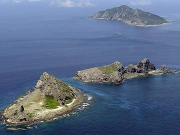 China says Japan's 'hype' on air defence zone spreads tension