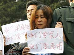 Angry relatives of MH370 passengers demand answers