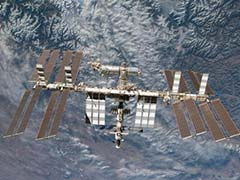Weather delays return from space of Russian torchbearers, US astronaut