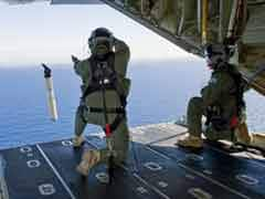 Australia switches to visual search for missing Malaysia Airlines jet MH370