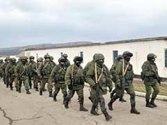 Crimean militias storm bases, arrest Ukraine navy chief