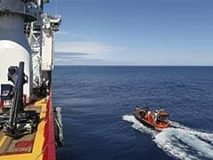 Ship hunts for more 'pings' in Malaysia Airlines jet search
