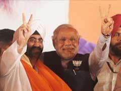 Prime Minister Manmohan Singh's step-brother joins BJP