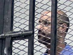 Moammar Gadhafi's son attends trial in Libya by video link