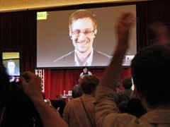 Edward Snowden, Glenn Greenwald urge caution of wider government monitoring at Amnesty event