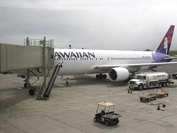 Boy who hid in plane's wheel well was undetected for hours before departure