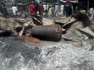 Blast hits bus park near Nigeria capital, at least 20 dead