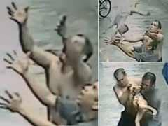 Chinese Men Catch Baby Falling from Building