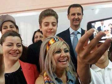 Syria's Bashar al-Assad Poses for a 'Selfie' as He, First Lady Vote