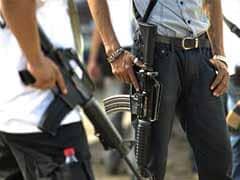 Mexican Forces Arrest 83 Vigilantes in Michoacan