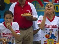 Hot Dogs Gobbled, Small-Town Parades Cheered as US Marks Soggy July 4