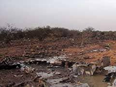 Investigators Scour Through Debris at Air Algerie Crash Site