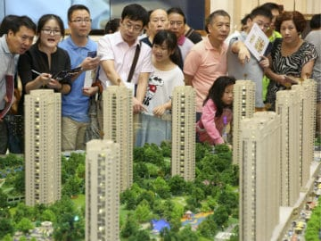 China Property Launches to Deepen Inventory Overhang, Price Declines