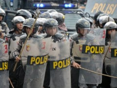 Indonesian Police Fire Tear Gas at Poll Protesters