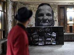 Street Artist Revisits Ghosts of Ellis Island Hospital