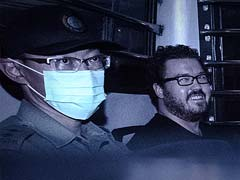 UK Banker on Double Murder Charge Grins Leaving Hong Kong Court