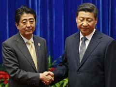 China, Japan Leaders Meet in Sign of Easing Tensions