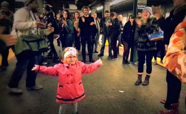 Stop Whatever You're Doing and Watch This Little Girl Start a Public Dance Party
