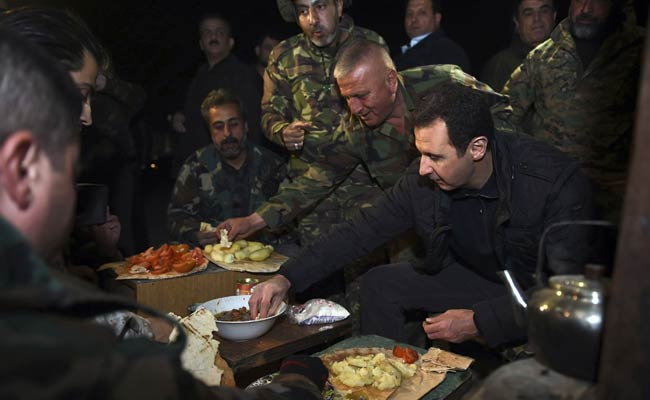 Syria's Assad Shown Hugging Troops in Embattled Damascus District