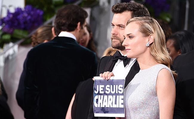 Stars at Golden Globe Awards Support Paris Victims, Free Speech