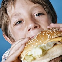 Children are being 'bombarded' by junk food ads, research has found
