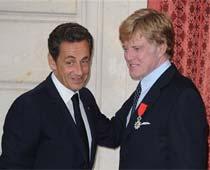 Robert Redford knighted by Nicolas Sarkozy