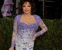 Joan Collins Rushed To Hospital From Oscars Bash