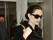 Angelina Jolie uses handcuffs